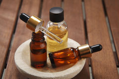 Massage oil. Three bottles massage oil on the wooden table stock images