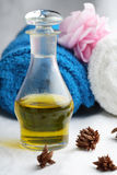 Massage oil and towels. Stock Photo