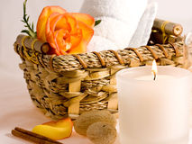 Massage oil and towels. Towels and massage oil with orange rose royalty free stock image
