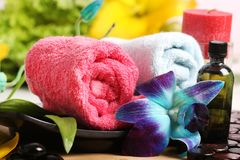 Massage oil and towels. Beautiful shot of massage oil and towels stock images