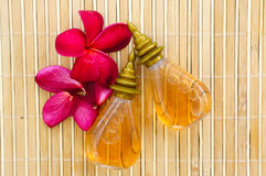 Massage oil for tropical spa concept Stock Images