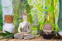 Massage oils with a Buddha figurine Stock Photos