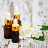 Massage oils and jasmine flowers Royalty Free Stock Images