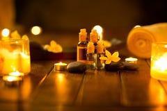 Massage oils in muffled light Stock Photos