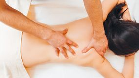 Massage osteopathy therapist dorsal manipulation stock images