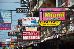 Massage and other multicolored signs on the street of Beach Road Royalty Free Stock Photography