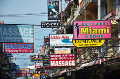 Massage and other multicolored signs on the street of Beach Road Royalty Free Stock Images
