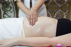 Massage pregnant woman Royalty Free Stock Photo
