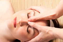 Massage procedure. Young woman on the  massage procedure Royalty Free Stock Photography