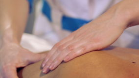 Massage procedure in spa salon.Massage of female back in the masseur.Masseur massaging the back of the girl. stock footage