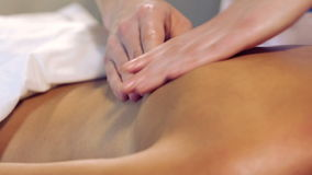 Massage procedure in spa salon.Massage of female back in the masseur.Masseur massaging the back of the girl. stock video footage