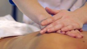 Massage procedure in spa salon.Massage of female back in the masseur.Masseur massaging the back of the girl. stock video