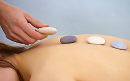 Massage procedure using round stones - Spa Stock Photography