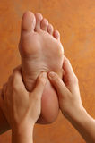Massage Reflexology On Foot Royalty Free Stock Photo