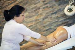 Massage for relax. Masseur makes Anti-cellulite massage on the buttock and thighs of the patient. Close up. Copy space stock photo