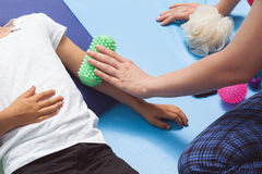 Massage roll in sensory therapy Stock Photos