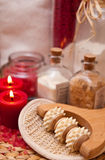 Massage roller and red candles royalty free stock images