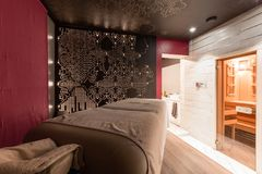 Massage room interior design in wellness and spa center. Dim lighting Royalty Free Stock Photo