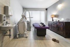 Massage room interior in wellness center. Massage room interior design in wellness and spa center stock photos