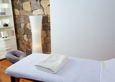 Massage room with massage table. And products with stone wall stock photography
