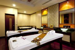 Massage room. Massage treatment room and spa ,  consisting of bench pillows towels and low level lighting Stock Photos