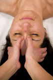 Massage at root of the nose Royalty Free Stock Photography