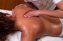 Massage in scapula Royalty Free Stock Image