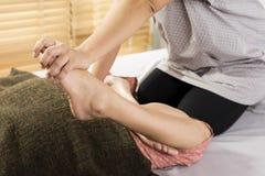 Massage series : leg massage Royalty Free Stock Images