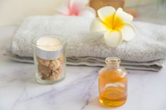 Massage set with Cinnamon essential oil massage. Massage set with Srilanka cinnamon essential oil, candle, towel and egg flowers. Landscape royalty free stock images