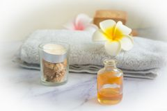 Massage set with Cinnamon essential oil massage. Massage set with Srilanka cinnamon essential oil, candle, towel and egg flowers. Landscape royalty free stock photo