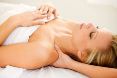 Massage: Shoulders Getting Massaged. Series of a young couple getting massages by therapists.  Together, as well as separate.  Bright and clean Royalty Free Stock Image