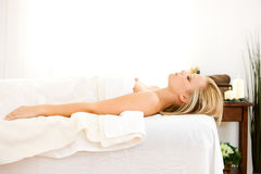 Massage: Side View of Woman Ready for Massage royalty free stock photo