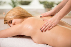 Massage in spa center. Woman having done massage in spa center Stock Photography