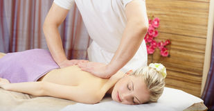 Massage in spa room Stock Photos