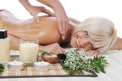 Massage in the spa salon Stock Photos
