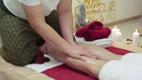 Massage Specialist Doing Massage of Womans Feet. At beauty spa stock video
