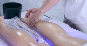 Massage specialist doing massage of womans feet at beauty spa.  stock video footage