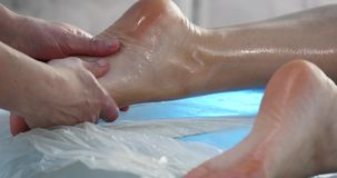 Massage specialist doing massage of womans feet at beauty spa.  stock footage
