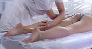 Massage specialist doing massage of womans feet at beauty spa.  stock video