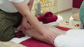 Massage Specialist Doing Massage of Womans Feet. At beauty spa camera move slider shoot stock footage