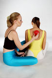 Massage with a Spike Ball. A Girl massaging another girl with a red spikeball Stock Photography