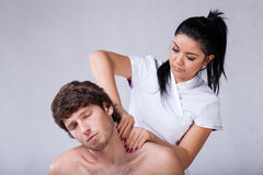 Massage of stiff neck Royalty Free Stock Photo