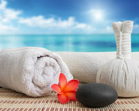 Massage still life on beach Royalty Free Stock Photo