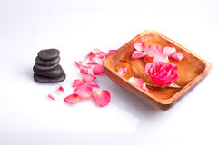 Massage stone with rose petal Stock Photo