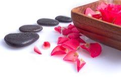 Massage stone with rose petal Stock Photos