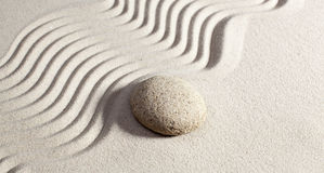 Massage stone for wellbeing. Natural harmony drawn in sand Stock Photo