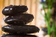 Massage stones. Stack of hot stones for lastone massage royalty free stock image