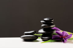 Massage stones with flowers on mat Royalty Free Stock Image