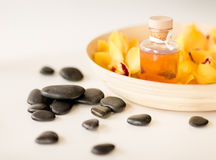 Massage stones with flowers on table Royalty Free Stock Photography