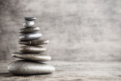 Massage stones put in the form of a pyramid Stock Photography